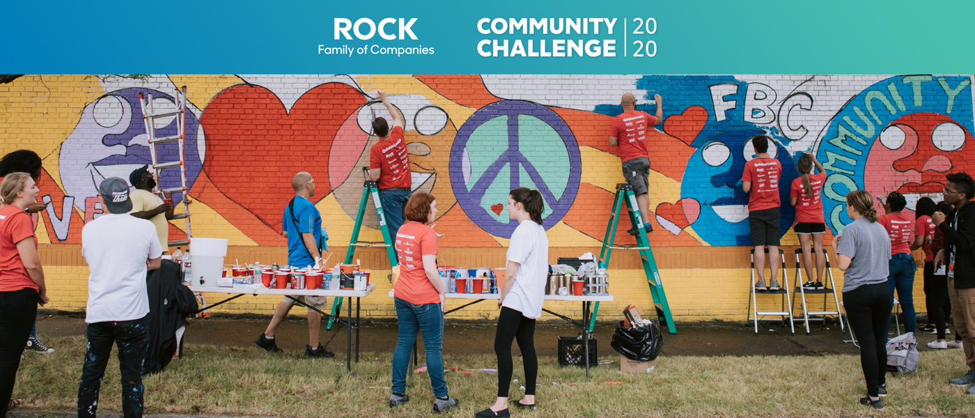 Community Challenge team members painting a mural