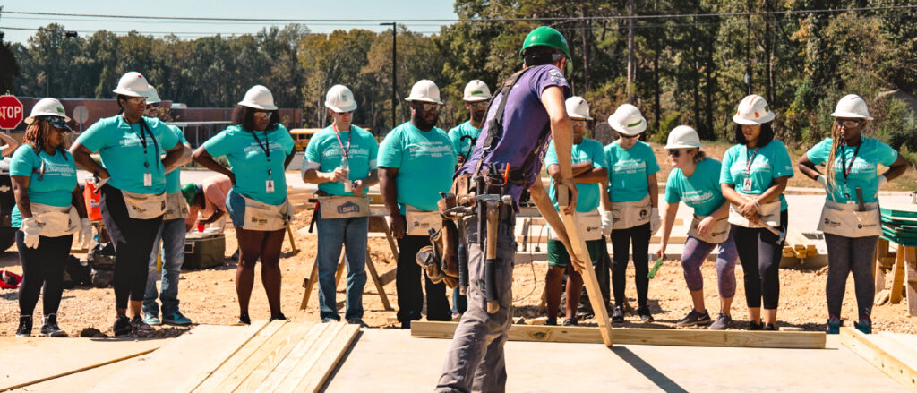 Habitat for Humanity volunteers breaking ground for a home build